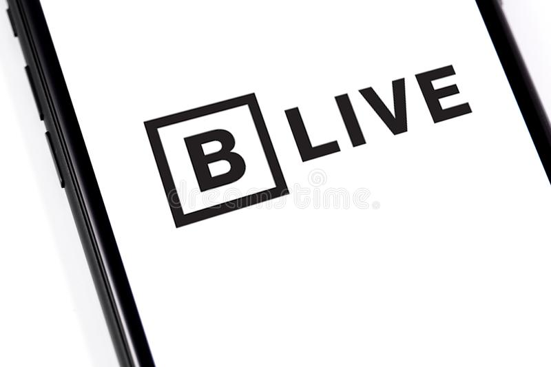 Closeup smartphone with BitTorrent LIVE logo. Website of BitTorrent, a communication protocol for peer-to-peer file sharing P2P. Moscow, Russia - March 26 stock image