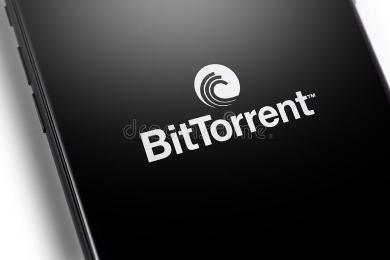 Closeup smartphone with BitTorrent logo. Website of BitTorrent, a communication protocol for peer-to-peer file sharing P2P. Moscow, Russia - March 26, 2019 stock photo