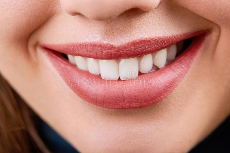Closeup of smile with white healthy teeth.Teeth whitening. Dental care. royalty free stock photos