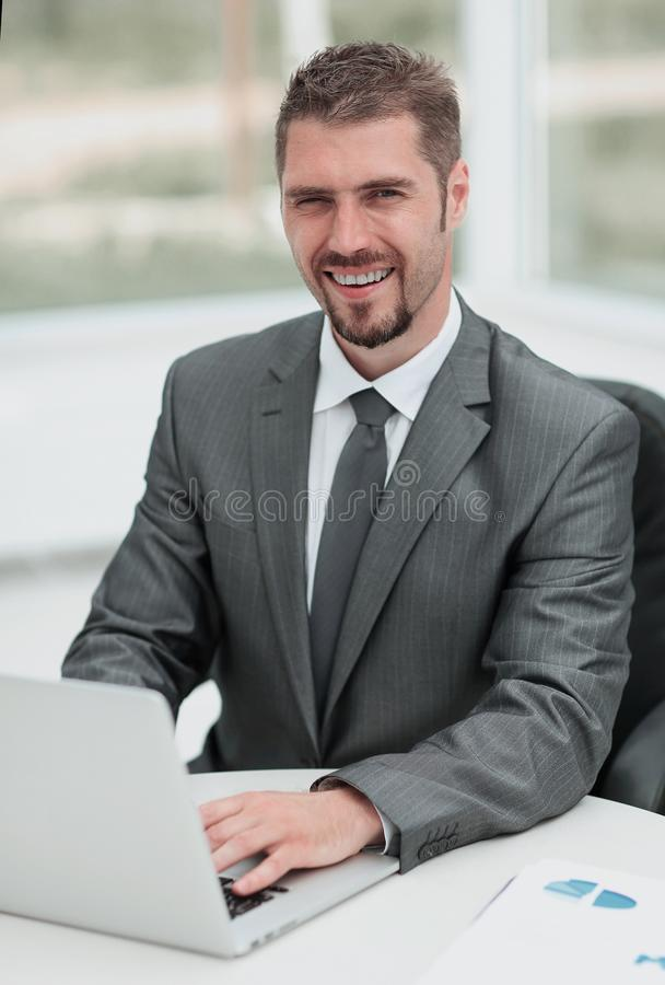 Closeup.smiling businessman working with laptop royalty free stock photos