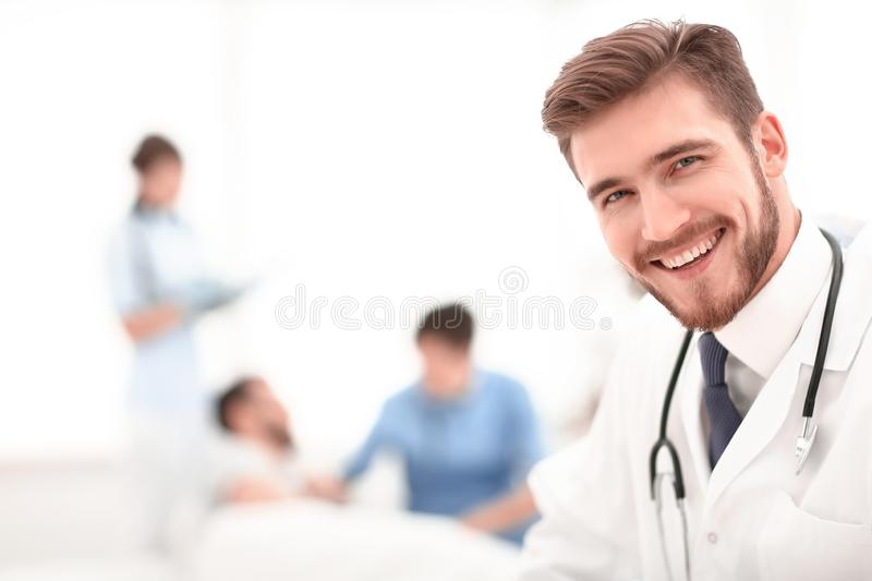 Closeup.smiling doctor on blurred background. The concept of health stock image