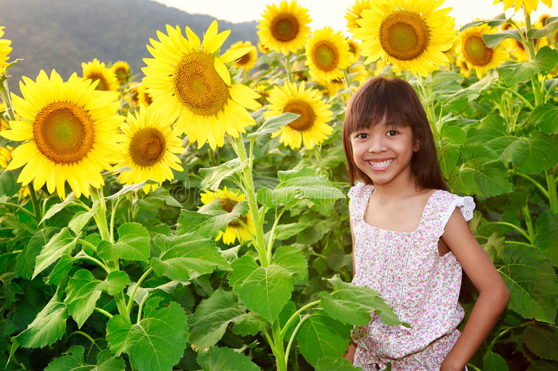 Download Closeup Smiling Girl In The Sunflowers Field Stock Photo - Image: 31258078