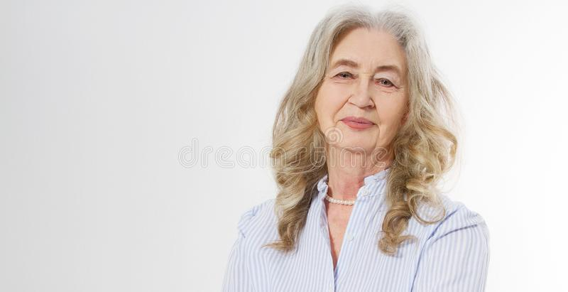 Closeup of smiling senior woman wrinkle face and gray hair. Old mature lady touching her wrinkled skin isolated on white. Background. Copy space. Banner royalty free stock image