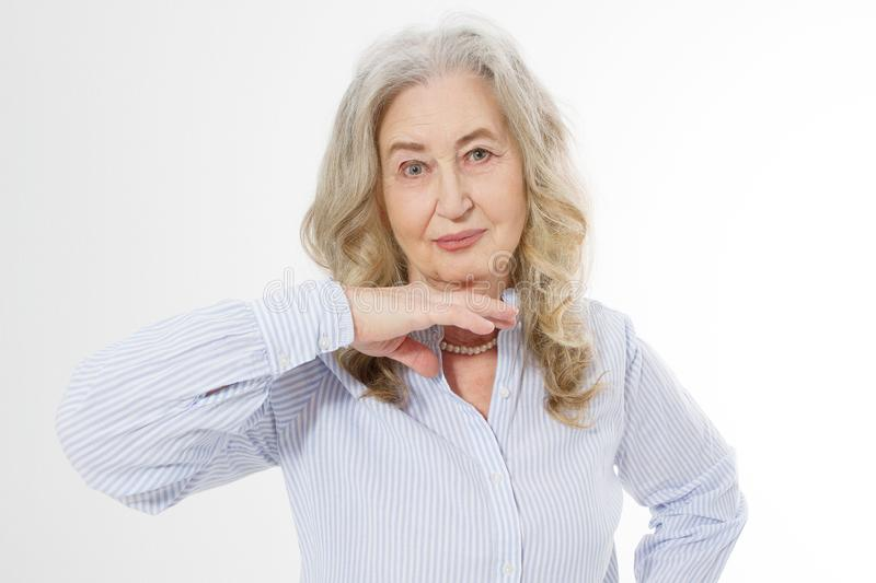 Closeup of smiling senior woman wrinkle face and gray hair. Old mature lady touching her wrinkled skin isolated on white stock photos