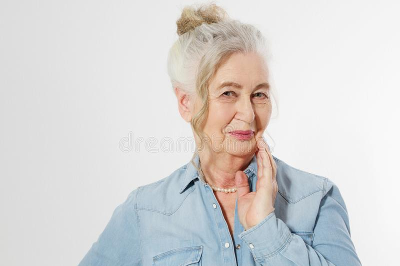 Closeup of smiling senior woman wrinkle face and gray hair. Old mature lady touching her wrinkled skin  on white stock photos
