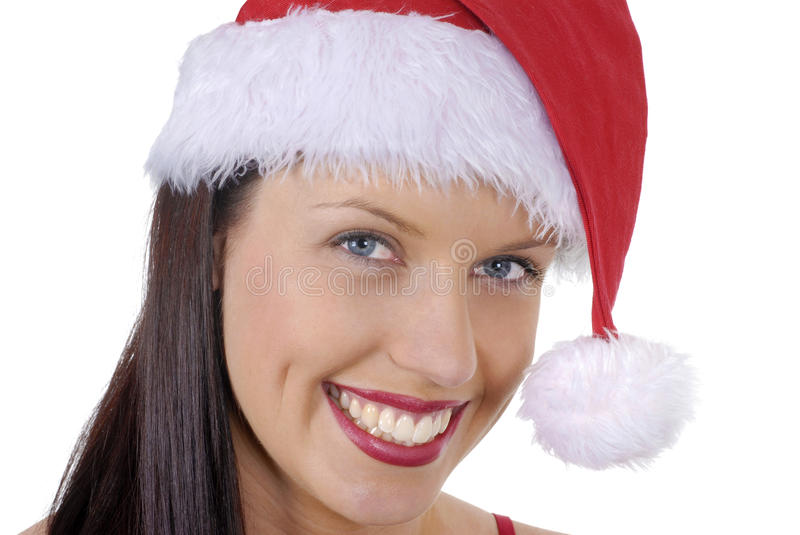 Closeup of smiling young adult woman with red Christmas Santa hat isolated on white stock images