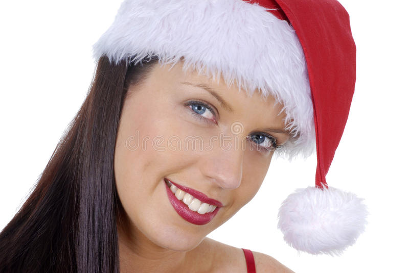 Closeup of smiling young adult woman wearing red Christmas Santa hat isolated on white royalty free stock image
