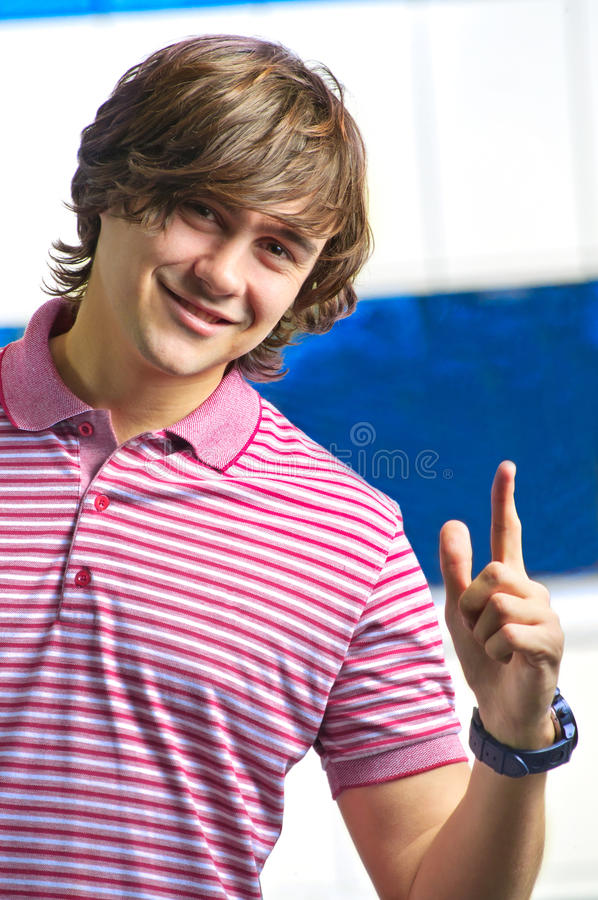 Download Closeup Of Smiling Young Man Pointing Up Stock Image - Image: 20143931