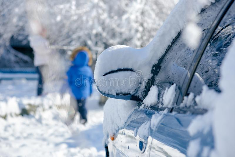 Snow-covered car mirror stock images