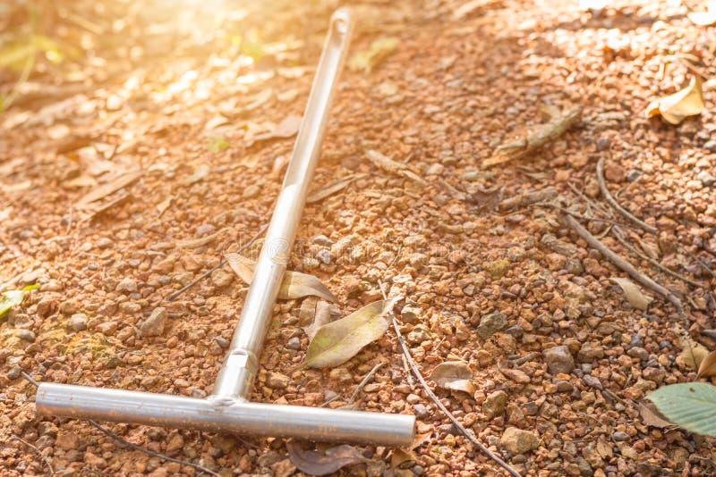 Closeup a soil sampling tube on the ground. royalty free stock photos