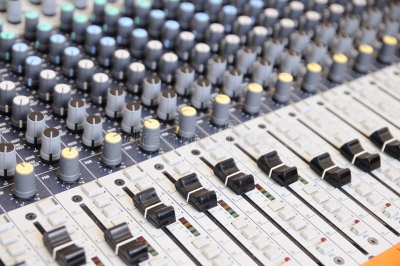 Closeup sound mixing control board.  stock photos