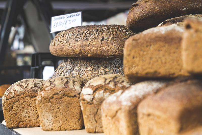Closeup of Sourdough and Rye Bread Loaves in Street Market royalty free stock image