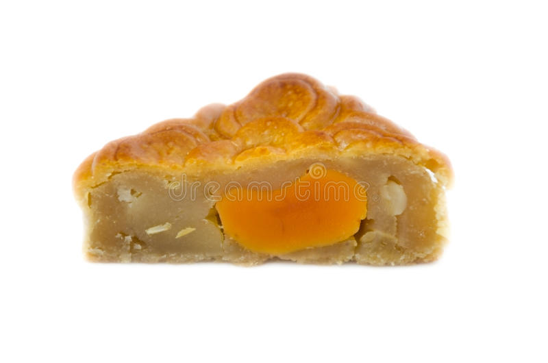 Closeup square moon cake in half cut show egg yolk isolated on stock photos