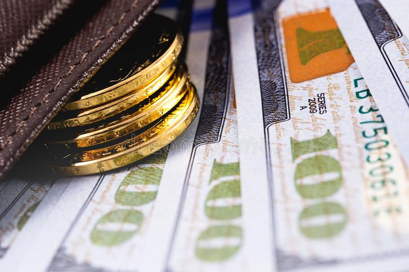 Stack golden metal coins. And dollars in wallet royalty free stock photos