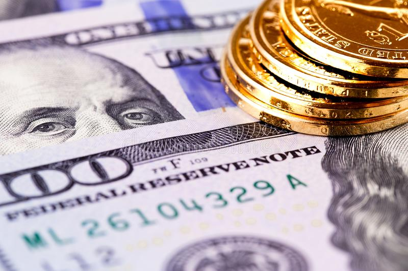 Stack golden metal coins. And hundred dollars banknotes royalty free stock photo
