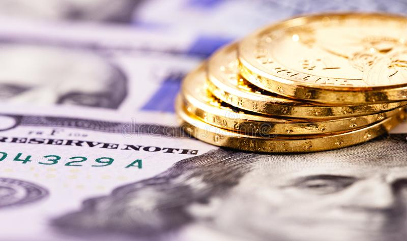 Stack metal coins. Dollars and hundred dollars banknotes stock photos