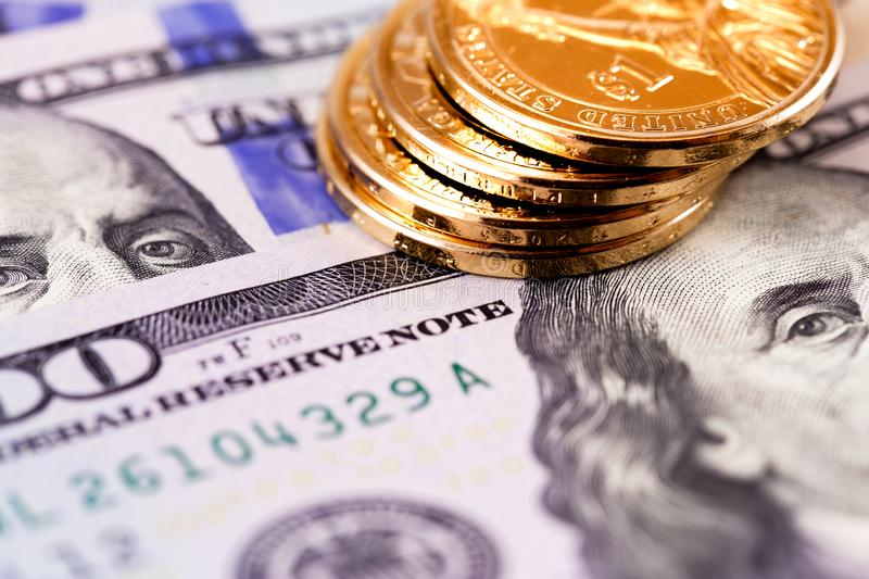 Stack metal coins. And hundred dollars banknotes stock photography