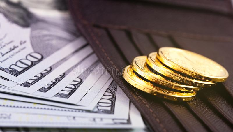 Stack metal coins. Hundred dollars banknotes with wallet stock photos
