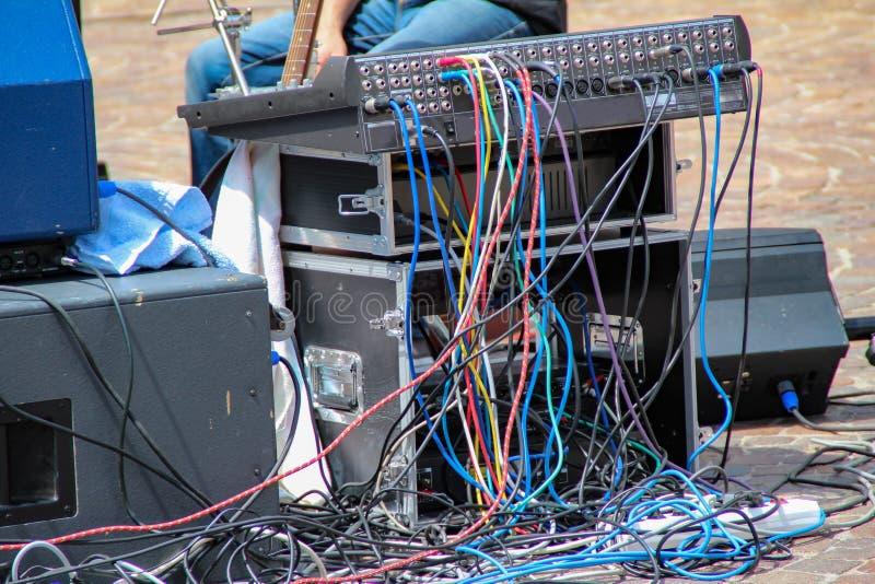 Closeup standard black audio cables rolled into bundle, studio equipment concept stock photography