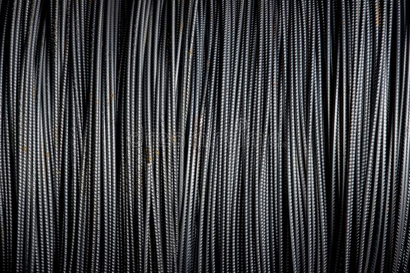 Closeup of steel bars. Closeup of black steel bars in a steel plant workshop .steel bars usually are used to reinforce concrete royalty free stock photography