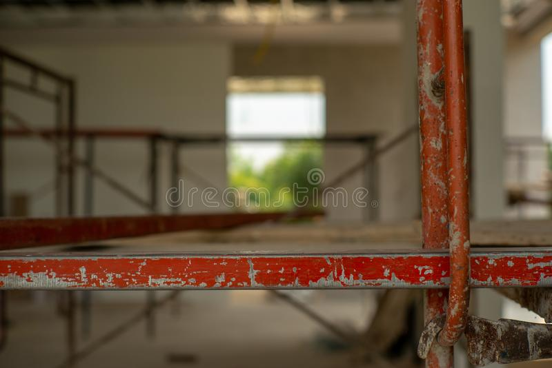 Closeup steel bars on the scaffolding for working at high level. At the construction site stock image