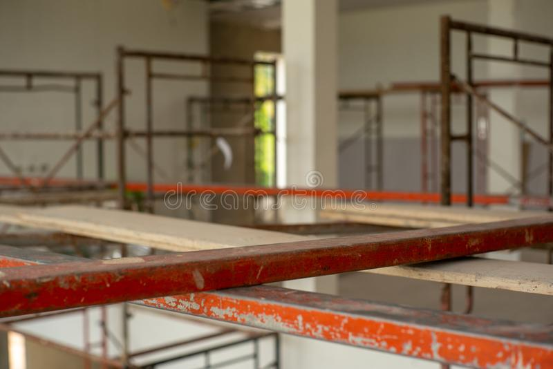 Closeup steel bars on the scaffolding for working at high level. At the construction site stock photography