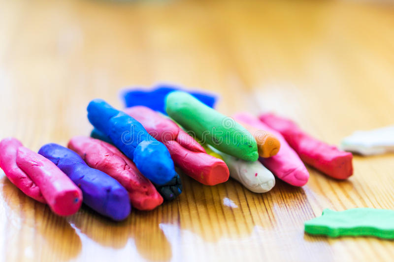 Closeup sticks, colored plasticine. Concept motor skills. Closeup sticks colored plasticine. Concept motor skills royalty free stock images
