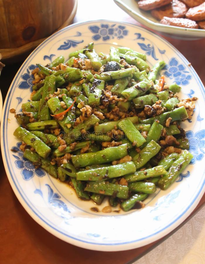Closeup of Stir fried long beans chinese style on dish. Close up of Stir fried long beans chinese style on dish royalty free stock images