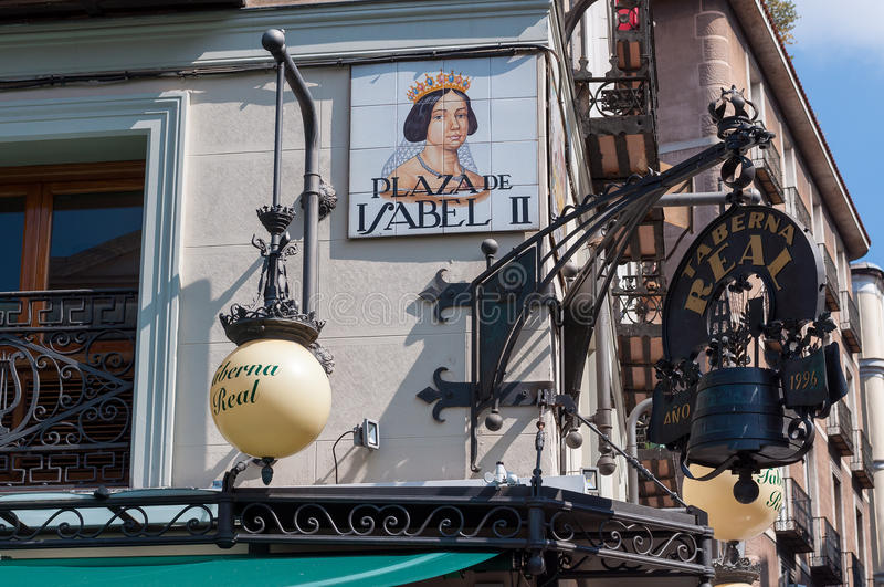 Closeup of the street sign. Plaza de Isabel II. Madrid, Spain. royalty free stock photo