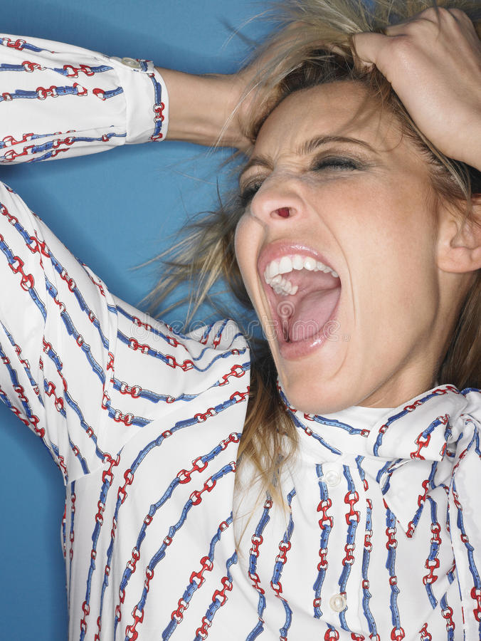 Closeup Of Stressed Young Woman Shouting