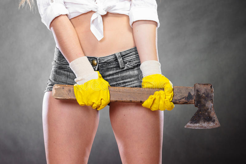 Closeup of strong woman feminist with axe working. Closeup of woman holding axe chopper. Strong girl feminist working in man profession. Independent female stock images