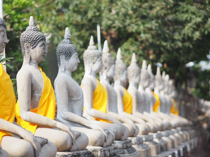 Stucco Buddha images in the Ayutthaya period enshrined at the Wat Yaichaimongkol, Buddhist Temple. Closeup Stucco Buddha images in the Ayutthaya period enshrined stock images