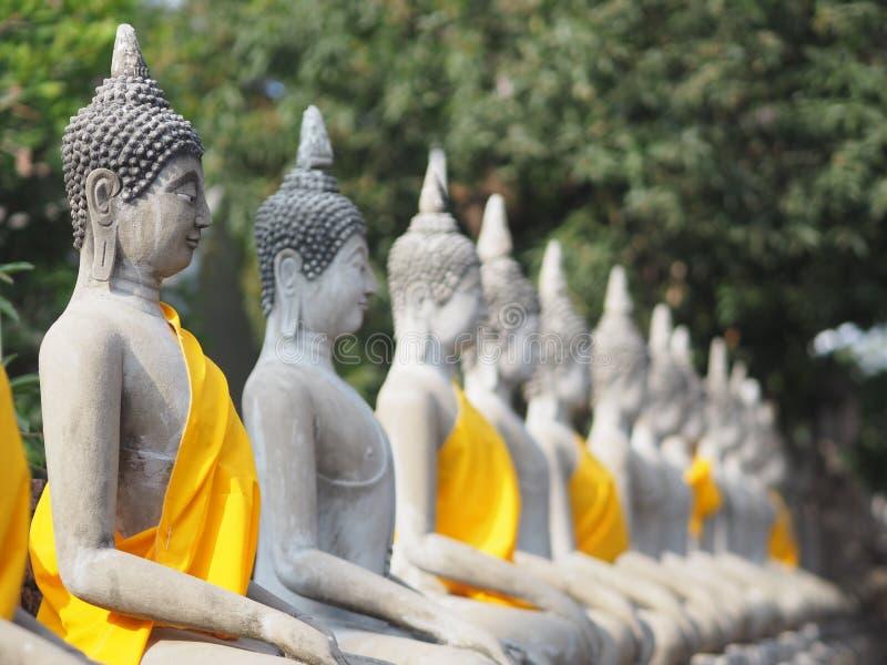 Stucco Buddha images in the Ayutthaya period enshrined at the Wat Yaichaimongkol, Buddhist Temple. Closeup Stucco Buddha images in the Ayutthaya period enshrined stock photography