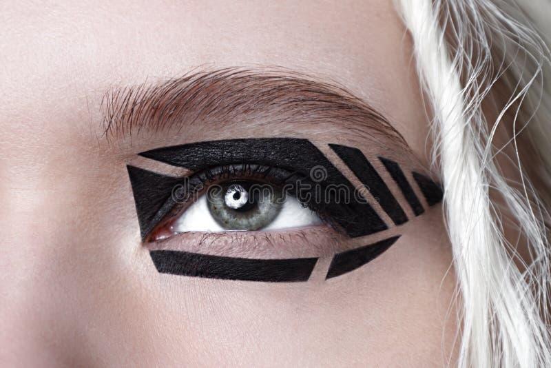 Closeup studio beauty photo of black graphic makeup. royalty free stock photography