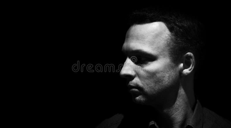Closeup studio profile portrait of young man stock photos