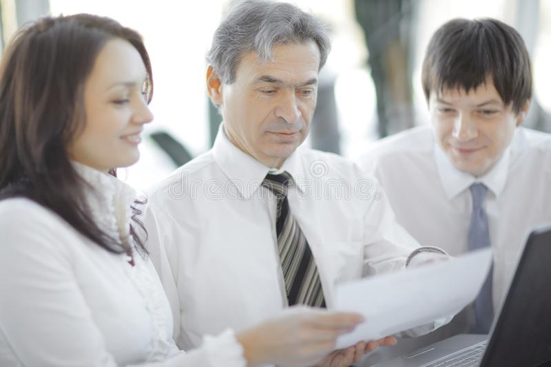 Closeup.business team discussing a new contract. stock photos