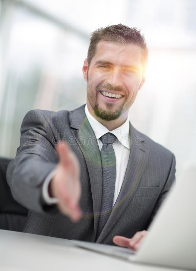 Closeup .a successful businessman extends his hand for a handshake, stock photography