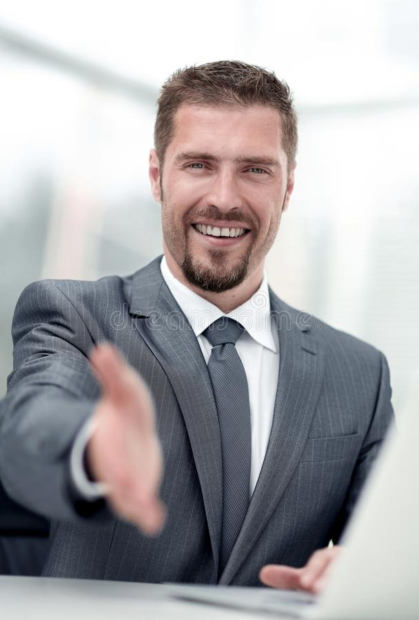 Closeup .a successful businessman extends his hand for a handshake, royalty free stock photos