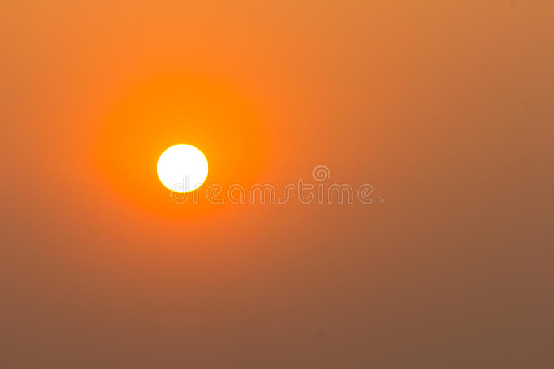 Closeup sunset in clear sky stock images