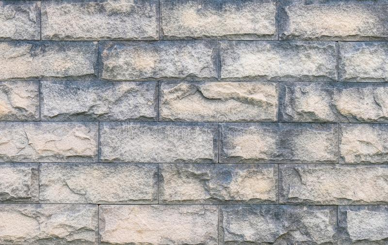 Closeup surface brick pattern at old stone brick wall textured background royalty free stock photography