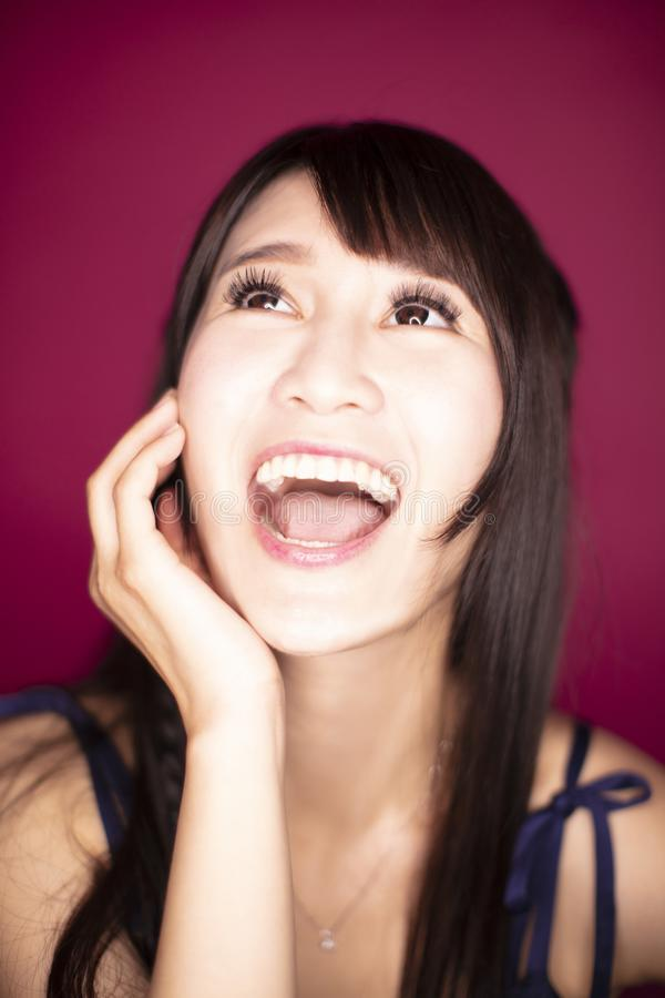 Surprised excited woman on red background stock photo