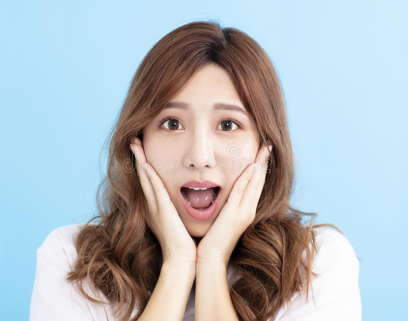 Closeup Surprised young woman face royalty free stock photography