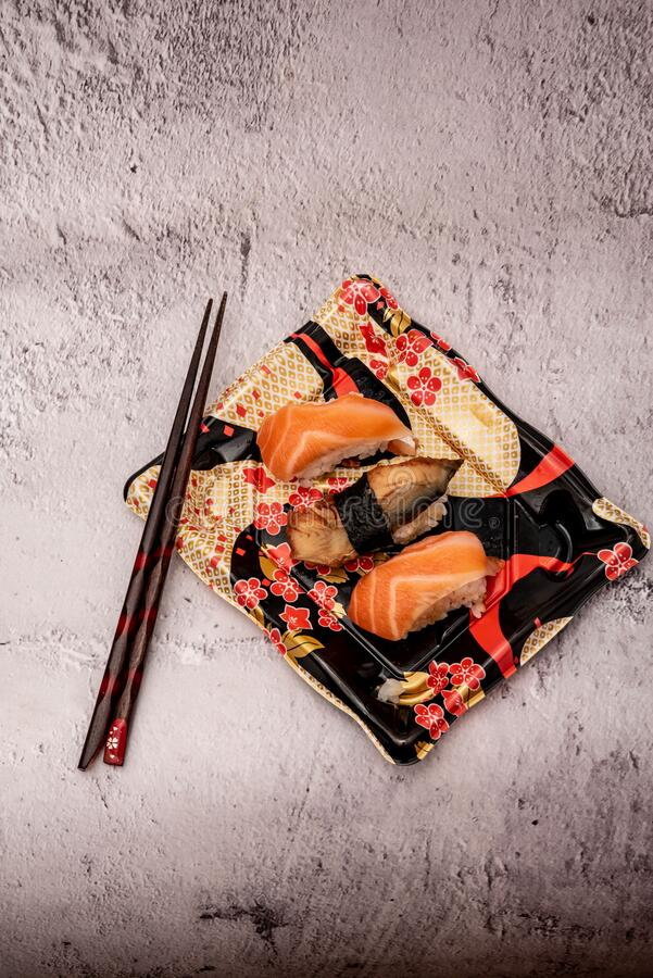 Sushi on the gray cement background. Closeup of sushi isolated on gray cement background stock photography