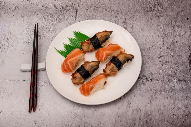 Sushi on the gray cement background. Closeup of sushi isolated on gray cement background royalty free stock image