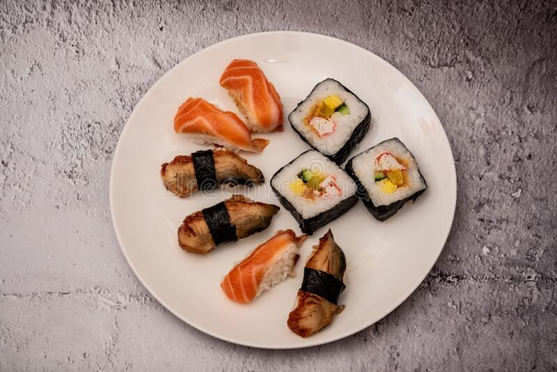 Sushi on the gray cement background. Closeup of sushi isolated on gray cement background stock image