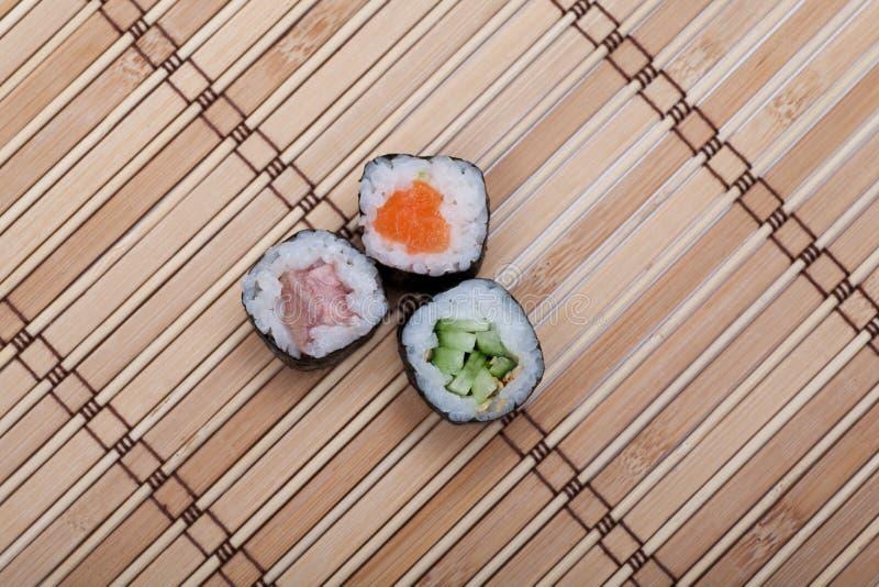 Closeup sushi roll on bamboo mat