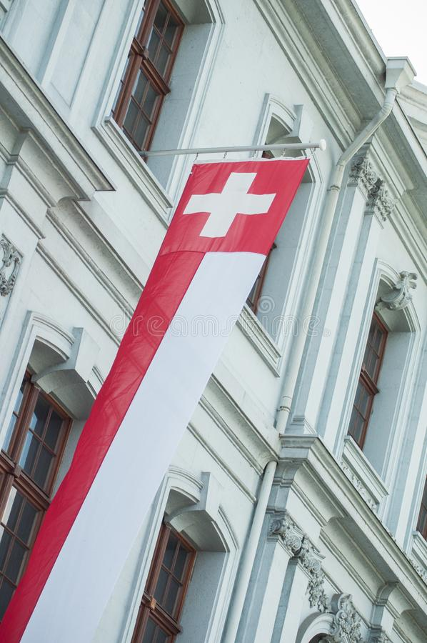 Swiss flag on building facade  in Switzerland royalty free stock photography