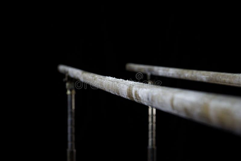 Closeup. Talcium powder over gymnastic parallel bars. Gymnastic parallel bars. Isolated on black background,. Closeup. Gymnastic parallel bars. Isolated on black royalty free stock image