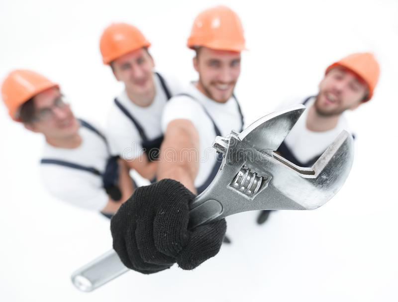 Closeup.a team of builders showing a pipe wrench stock photo
