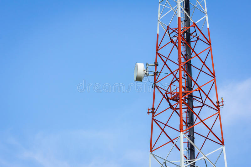 Closeup telecommunication tower and cloudy blue sky with copyspa. Ce on the left royalty free stock photography